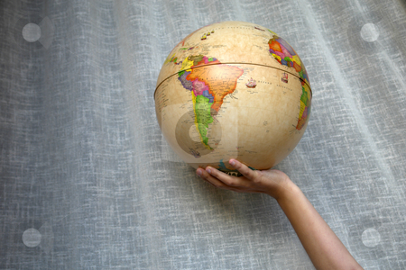 Globe stock photo, World globe detail in a woman hand by Rui Vale de Sousa