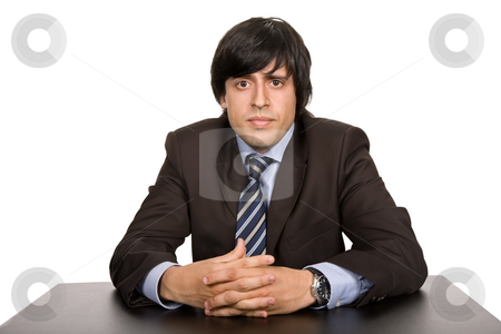 Worker stock photo, Young bored businessman on a desk, isolated on white by Rui Vale de Sousa