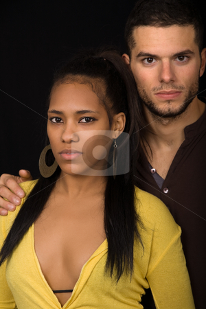 Couple stock photo, Young couple together portrait on black background by Rui Vale de Sousa