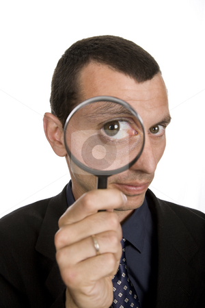 Loupe stock photo, Business man with a loupe isolated on white by Rui Vale de Sousa