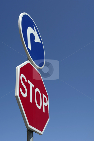 Sign stock photo, Metal stop sign close up with the sky as background by Rui Vale de Sousa