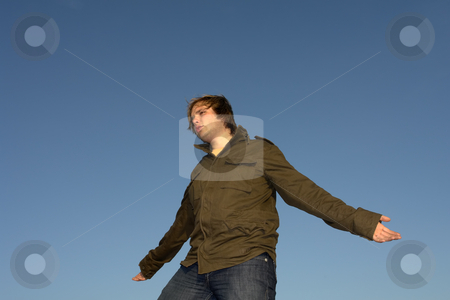 Happy stock photo, Young man with arms wide open at sunset light by Rui Vale de Sousa