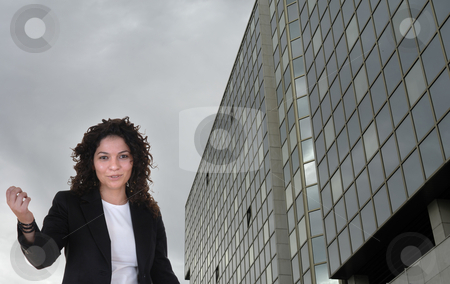 Saleswoman stock photo, Young saleswoman with a modern office building by Rui Vale de Sousa