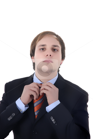 Adjusting stock photo, Businessman fixing his tie isolated in white background by Rui Vale de Sousa
