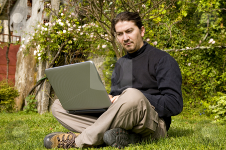 Working stock photo, Young man working with laptop at the garden by Rui Vale de Sousa
