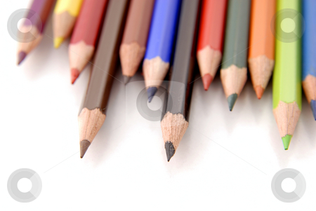 Pencils stock photo, Color pencils aligned and isolated on white, focus on the midle one by Rui Vale de Sousa