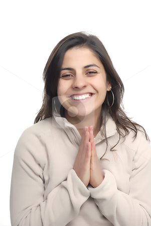 Pray stock photo, Young girl praying and laugh in a white background by Rui Vale de Sousa