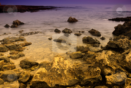 Ocean stock photo, Long Exposure of sea over rocks - dreamy feel by Rui Vale de Sousa