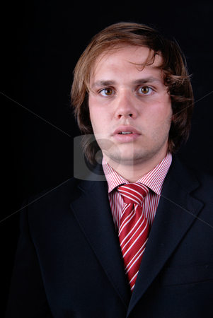 Man stock photo, Young mad man portrait on black background by Rui Vale de Sousa