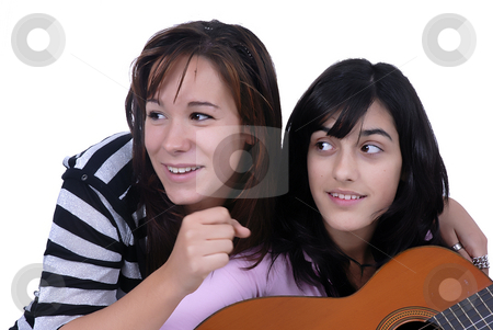 Play stock photo, Two young casual girls portrait in studio by Rui Vale de Sousa