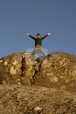 Happy stock photo, Young man with arms wide open and the sky as background by Rui Vale de Sousa