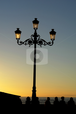 Sunset stock photo, Street light at sunset in the coast by Rui Vale de Sousa