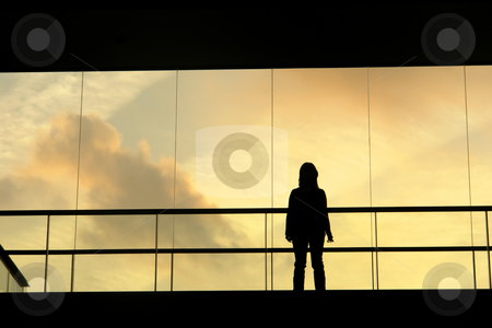 Lines stock photo, Woman in the modern buildind at sunset by Rui Vale de Sousa