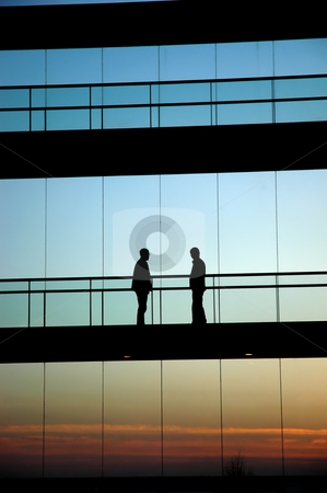 Workers stock photo, Two workers inside the building silhouette at sunset by Rui Vale de Sousa