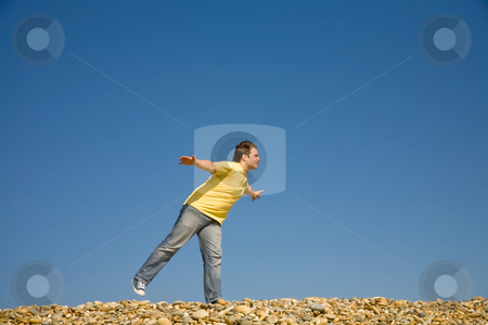 Flying stock photo, Man with arms wide open at the beach by Rui Vale de Sousa