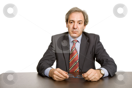 Pensive stock photo, Mature business man on a desk, isolated on white by Rui Vale de Sousa