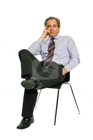 Seat stock photo, Mature businessman on a chair, isolated on white by Rui Vale de Sousa