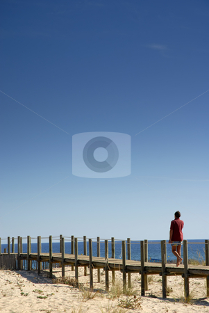 Walking stock photo, Man in the wood path at the beach by Rui Vale de Sousa
