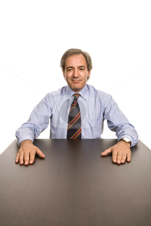 Happy stock photo, Mature business man on a desk, isolated on white by Rui Vale de Sousa