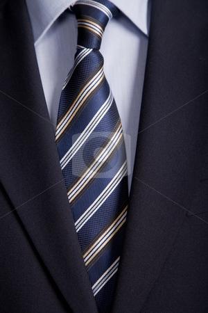 Blue tie stock photo, Detail of a business man suit with blue tie by Rui Vale de Sousa