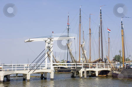 Volendam Harbor stock photo, The old harbor in Volendam, the Netherlands, with a drawbridge, and old commercial sailing ships moored in the harbor by Corepics VOF