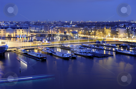 Amsterdam stock photo, Amsterdam harbor at night, with traffic racing through the streets, and lights illuminating the various historic buildings by Corepics VOF