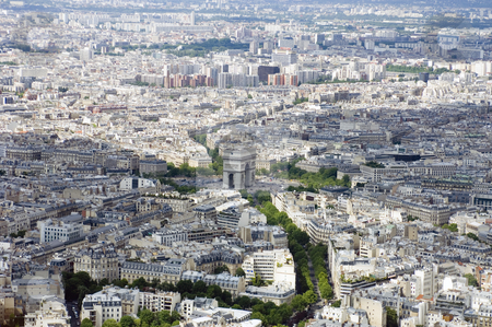 Paris from Above stock photo, Paris from above, seen from the Eiffel Tour. In the center is the Arc de Triomphe as figurative centerpoint between two patches of clouds. The lush, tree-lined avenues, including the Champs Elisee are clearly visible by Corepics VOF