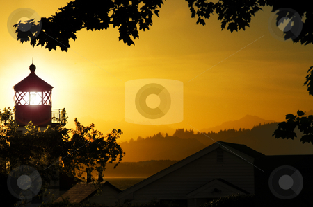 Lighthouse Sunset stock photo, Alki Point lighthouse, looking out over the Olympic Peninsula during a radiant sunset by Corepics VOF
