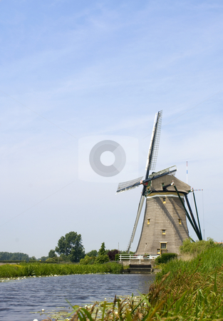 Dutch Windmill stock photo, A typical Dutch Windmill, used for water management to keep the polders dry near Leidschendam, The Netherlands by Corepics VOF