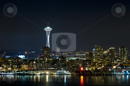 Seattle Skyline at night stock photo, The iconic Seattle Skyline at night on an overcast night, as seen from West Seattle across the bay by Corepics VOF