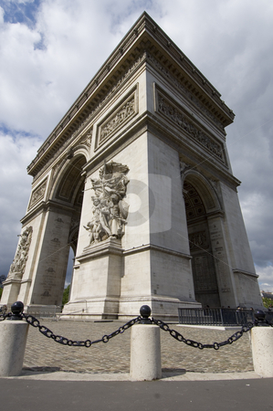 Arc de Triomphe up close stock photo, The famous landmark the Arc de Triomphe on the Champs Elisee in Paris seen through a wide angle, enhancing the perspective, from nearby, showing the sheer size of the monument by Corepics VOF