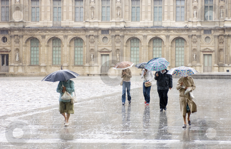 Heavy Rain at the Louvre stock photo, Pedestrians, rushing for cover at the Louvre during a heavy shower. by Corepics VOF