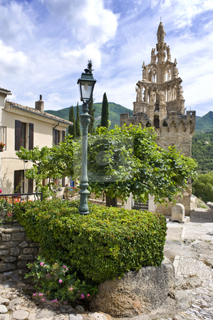 The Old Quarter of Nyons stock photo, Details of the old quarter in the city of Nyons, Drome, France, with the typical French houses, classical lamp post, and quaint cobblestone streets and an old chapel by Corepics VOF