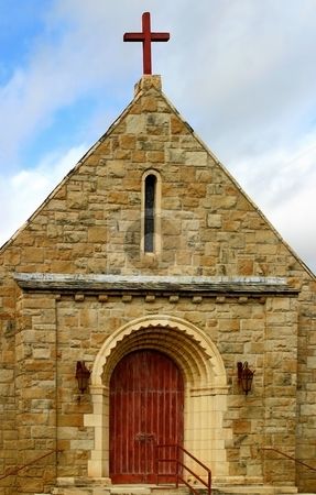Little Church stock photo, Front view of a little old stone chruch . by Henrik Lehnerer