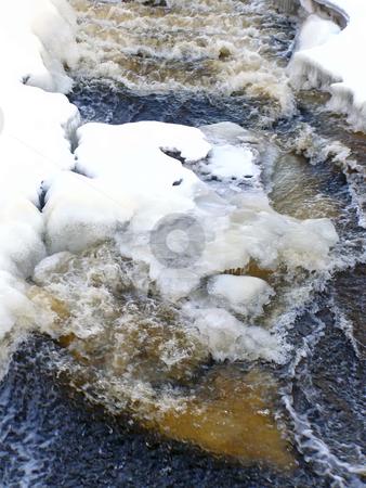 Cold stream stock photo, Stream of water run through the snow and ice by Sergej Razvodovskij