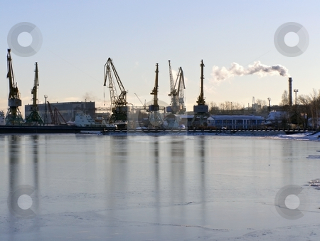 Winter industrial port stock photo, Winter cargo side port with big ships and cranes by Sergej Razvodovskij