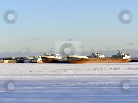 Ships on the ice stock photo, Many ships in ice of the frozen winter sea by Sergej Razvodovskij