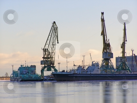 Winter port with cranes stock photo, Winter cargo side port with big ships and cranes by Sergej Razvodovskij