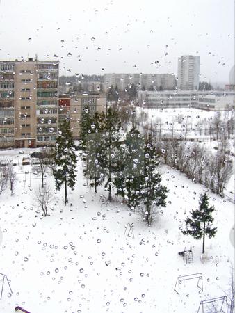 Through the window stock photo, Town view through the window with the drops by Sergej Razvodovskij