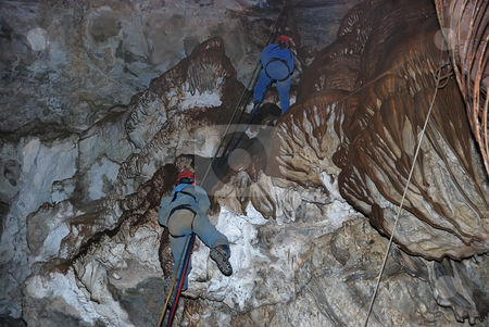Climbers in Cavern stock photo, Two climbers on a rope in a cavern. by Denis Radovanovic