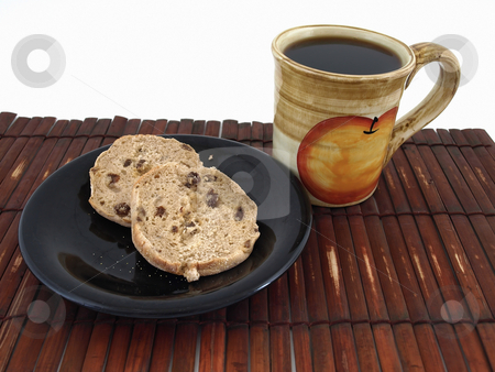 Evening Snack stock photo, A cinnamon raisin muffin and a hot cup of coffee on a bamboo mat. Isolated over white. by Robert Gebbie