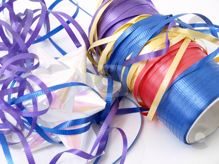 Ribbon Mess stock photo, A tangle of colorful ribbons isolated against a white background. by Robert Gebbie