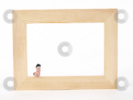 I Otta Be In Pictures stock photo, A cute EarthWerm in a bowler hat sits on the edge of a blank tan wood frame over a white background. Photographer holds copyright on figurines. by Robert Gebbie