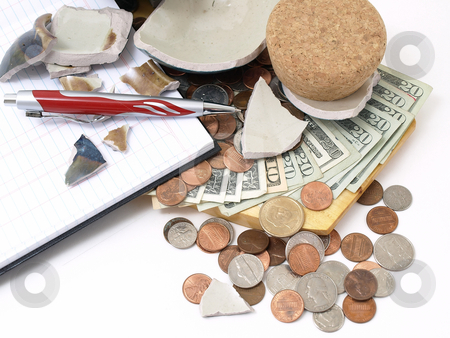 Borrowing From Myself stock photo, An open ledger and pen next to a broken ceramic bank on a pile of loose United States coins and currency. by Robert Gebbie