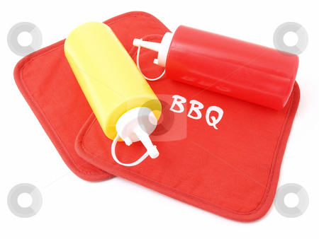 Ketchup and Mustard Containers stock photo, Ketchup and Mustard squeeze bottles laying on two red potholders. by Robert Gebbie