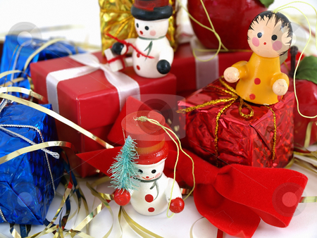 Colorful Wooden Ornaments stock photo, Cute colorful wooden Christmas tree ornaments, displayed with colorful wrapped presents. Over white. by Robert Gebbie