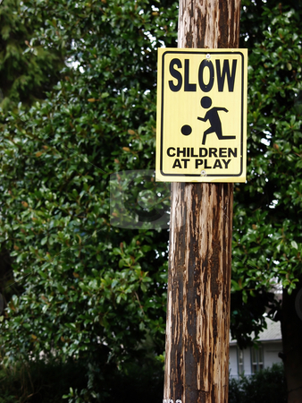 Slow Children at Play sign stock photo, Slow Children at Play sign in a neighborhood area. by Robert Gebbie