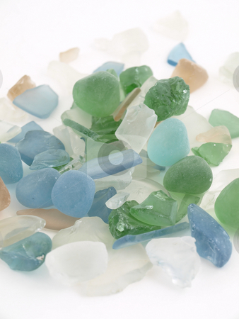 Colorful Glass Stones stock photo, Colorful stones of glass in various blue tones isolated over a white background. by Robert Gebbie