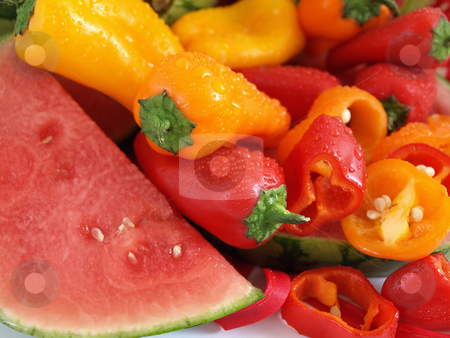 Summer Colors stock photo, A vibrant summer crop of fresh juicy watermelon and colorful bell peppers, with water drops, studio isolated over a white background. by Robert Gebbie