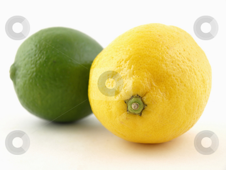 Lemon Lime stock photo, A green lime and a yellow lemon isolated on a white background by Robert Gebbie